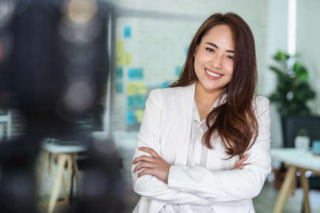 Portrait of Asian Business woman with thumbs up like when recording video for social influence at modern workplace,human resource and small business owner, vlogging and social network concept