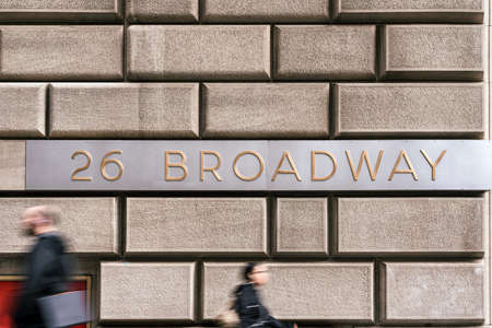 """Broadway Street """"26 BROADWAY"""" sign and wall street over vintage wall beside the street, Broadway is a road in the U.S. state of New York, Business and sing of landmark concept"""