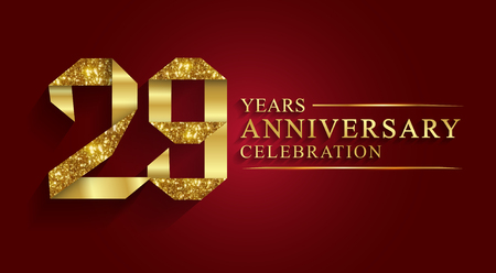 29 years anniversary celebration greeting. Ribbon golden number on red background.Numbers ribbon gold foil.