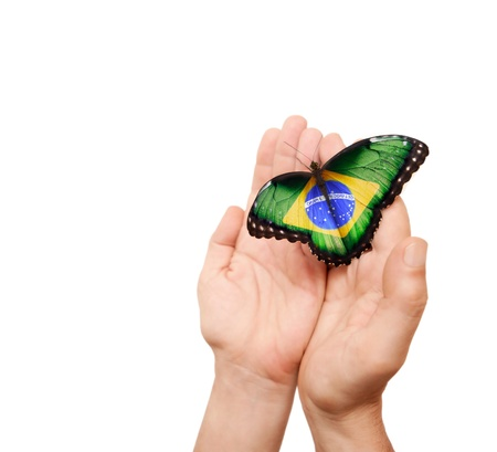 Brazil flag butterfly on a man Standard-Bild