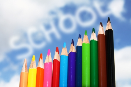 back to school concept made of colorful pencils against blue sky  with clouds