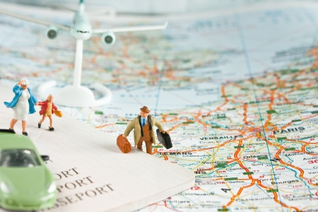 travel concept: travel concept with passport, car, and airplane on a world map with Paris city in focus