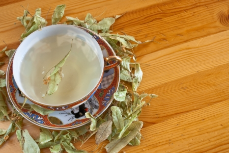 cup of linden tea with linden flowers on a wooden table Stock Photo