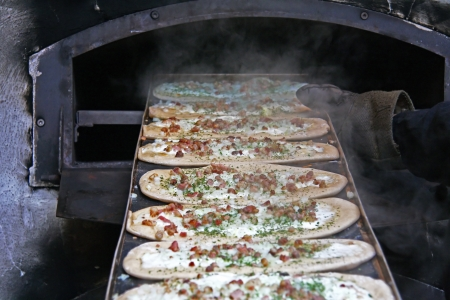 preparing pizza in a  traditional brick oven Stock Photo