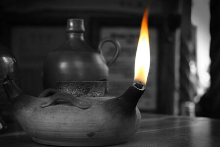 Burning flame in a vintage lamp in black and white  Stock Photo