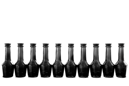 row of bottles in black and white