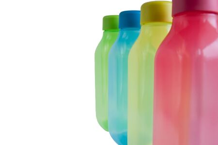 colorful plastic water containers isolated on white