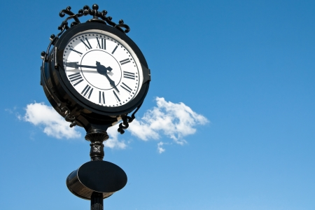 vintage style city clock against blue sky