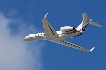 Private corporate business jet in flight Stock Photo