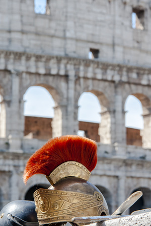 Roman helmet in front of Colosseum in Italy Stock Photo