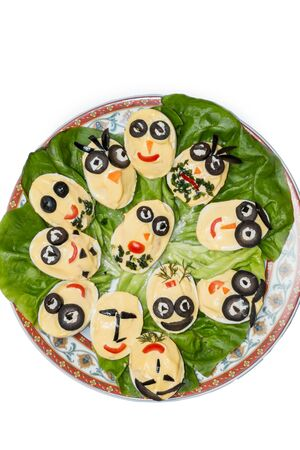 deviled eggs: Plate with deviled eggs looking like faces