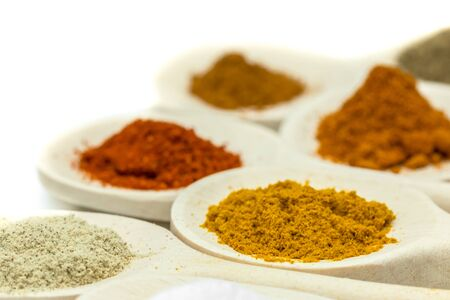 White spoons filled with spices Stock Photo