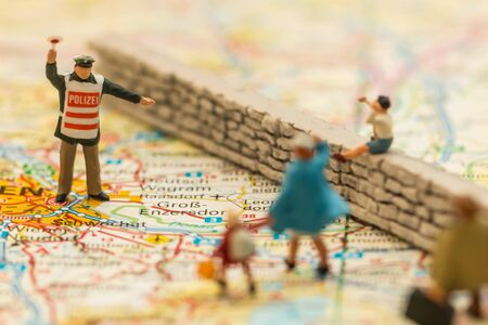 suggested: Refugee crisis in Europe, suggested by people on a map Stock Photo