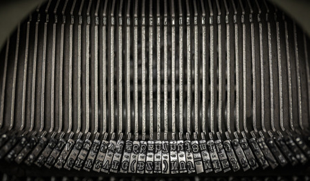 Details of type hammers inside a typewriter
