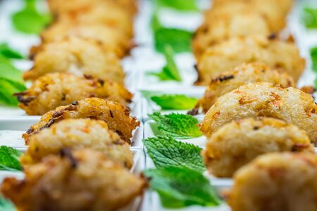 Breaded chicken nuggets and peppermint leaves Stock Photo
