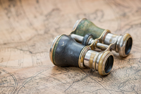 Pair of binoculars on a vintage map
