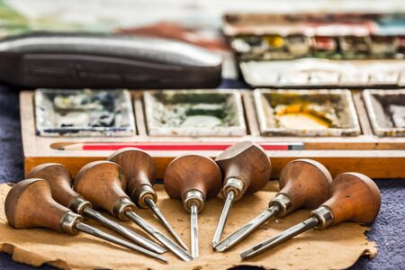 Artist tools on wooden surface
