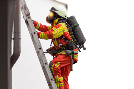 Fireman in action, climbing a ladder