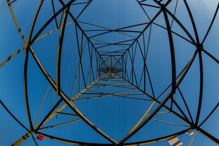 Energy concept with power lines against blue sky