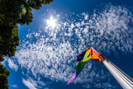 Gay pride -flag against the blue sky