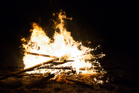 Burn fire with wood on beach camp Stock Photo