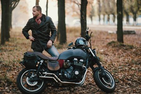 Motorcyclist on the old cafe-racer motorcycle, autumn background Zdjęcie Seryjne