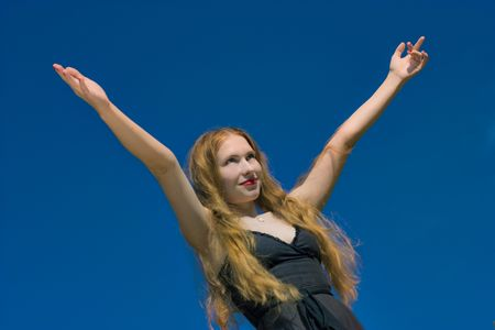 heave: young beautiful woman and blue sky as background