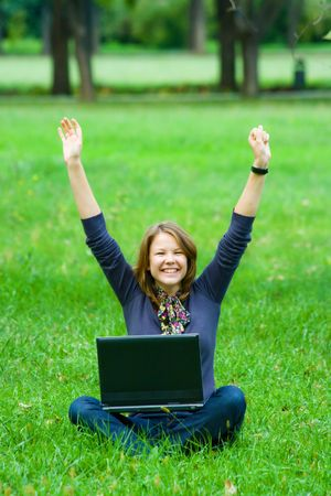 blond girl with laptop on a grass Stock Photo - 5654245