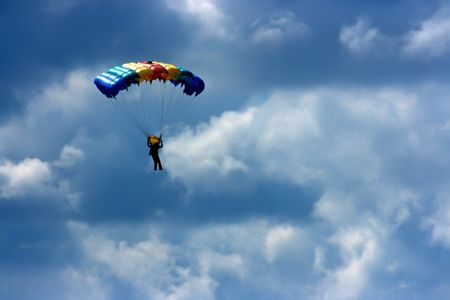 colored parachute in the sky