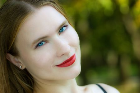 Pretty smiling blond woman with blue eyes Stock Photo - 5654231