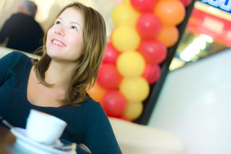 young pretty business woman drinking coffee in cafe Stock Photo - 5886911