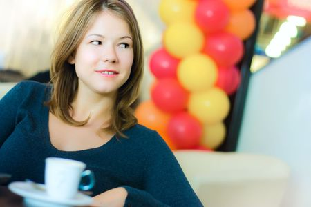 young pretty business woman drinking coffee in cafe Stock Photo - 5886912