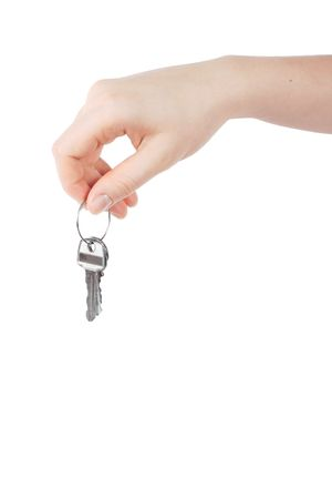 clouseup shot of a female hand holding keys photo