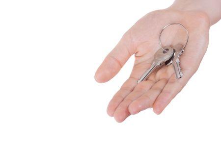 clouseup shot of a female hand holding keys photo