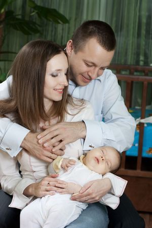 happy family at home: mother, father, little baby and happiness Stock Photo