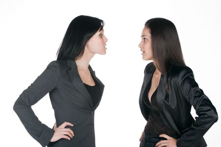 differing: two young pretty business women differing - isolated on white background Stock Photo