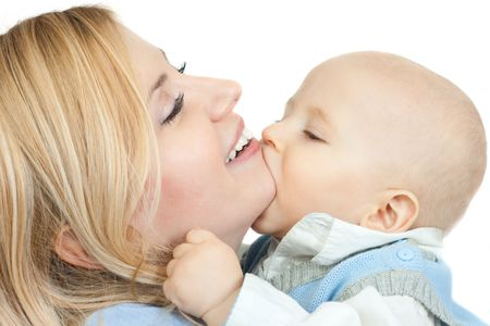 happy family: cute little boy kissing his mother - isolated on white background