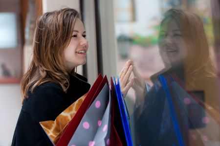beautiful young woman with shopping bags photo