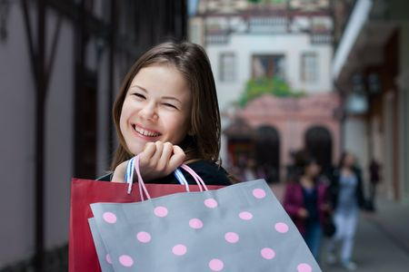beautiful young woman with shopping bags outdoors Stock Photo - 6570415