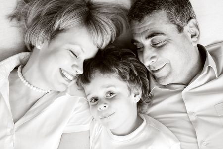 happy family home: father, mother and - black and white photo