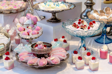 Delicious wedding reception candy bar dessert table full with panacota and edible silver. Luxury life.