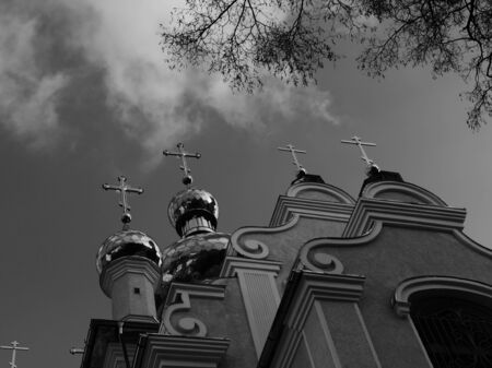 Orthodox crosses on the turrets of the church and branches of winter trees.