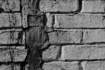 Stuccoed facade of an old brick wall.