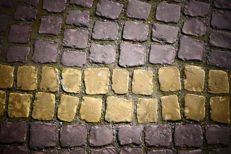 A curious pavement of stones of different colors, laid next to one of the government offices in the center.