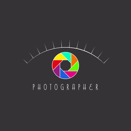 Abstract eye of the photographer, colorful aperture of the camera, site logo