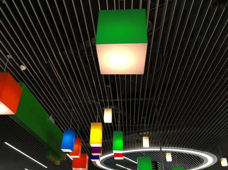 chandelier background: Plastic multicolored chandeliers on a modern striped metal ceiling. Modern design of industrial interior. Colorful cubic geometric shapes background.