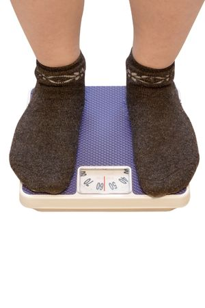 kilograms: legs on a scales under the light background Stock Photo