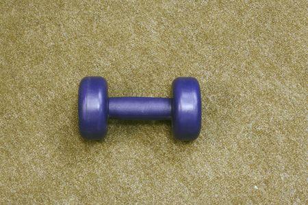 kilograms: Plastic gym on the  carpet Stock Photo