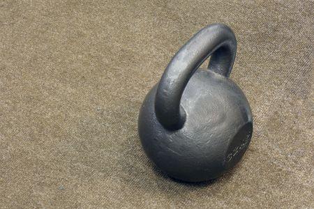 kilogram: 32- kilogram weight on the carpet Stock Photo