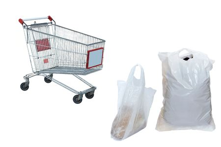 Plastic bags and the shopping trolley under the white background Stock Photo - 4505468